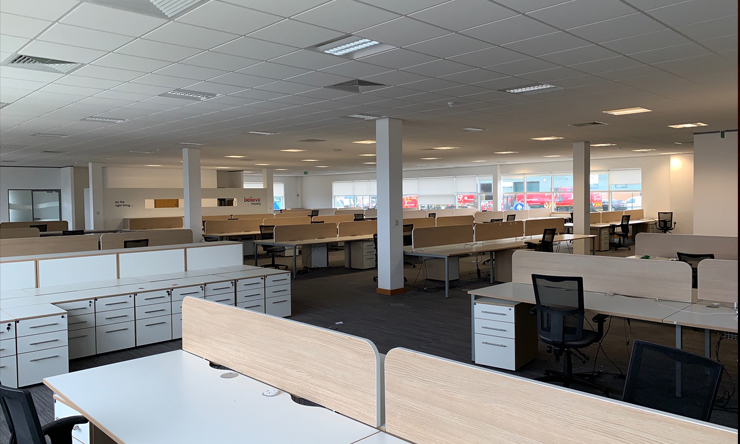 Empty office with large number of available desks